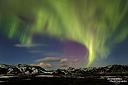 Tanzende Polarlichter am nächtlichen Himmel während unserer März-Tour nach Island