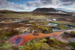 In Austur Reykjadalir gibt es auch sonst viel zu entdecken, ein Geothermalgebiet voller bunter Quellen und Schlammtöpfe.